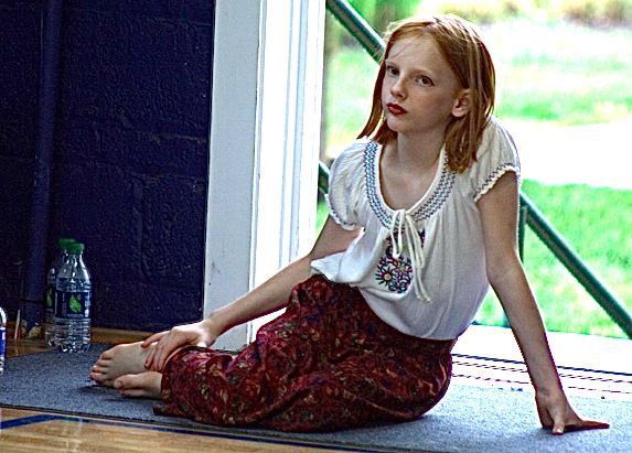 Young Rose resting by the stage door.